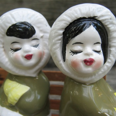 Kissing lady eskimos on a bench salt and pepper shakers