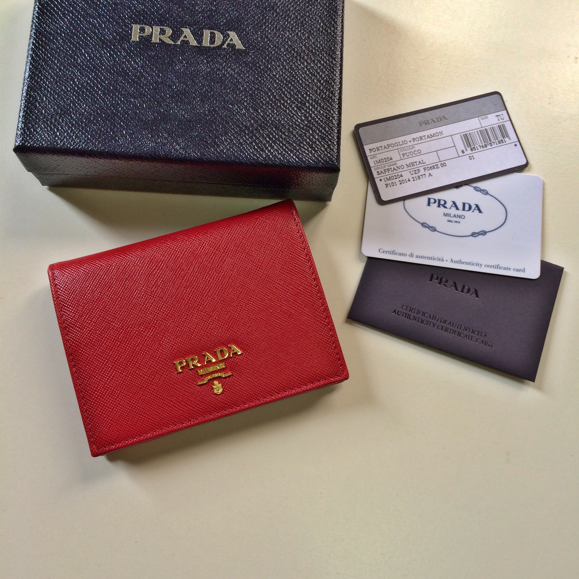 1f64b296cb24 the little green suitcase | PRADA Saffiano Fuoco Bi-Fold Wallet ...