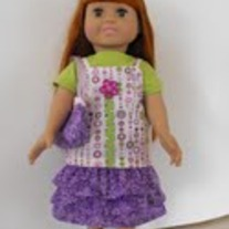 Green tshirt, purple and green camisole, purple ruffle skirt, purse