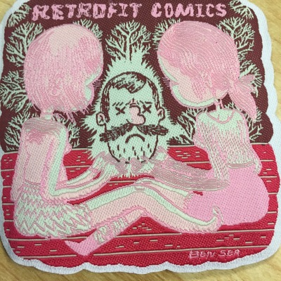 Retrofit comics patch designed by ben sea