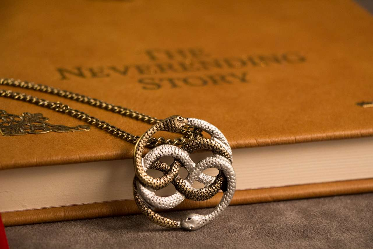 Geekify neverending story auryn pendant gold and silver two tone neverending story auryn pendant gold and silver two tone thumbnail 2 mozeypictures Choice Image
