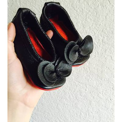 Black flats with bow and red soles
