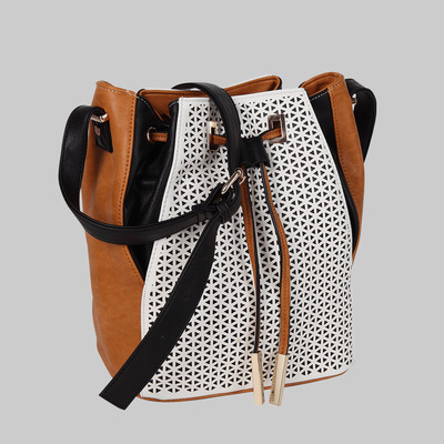 Ella laser cut bucket bag by melie bianco
