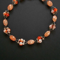 "17"" Orange beaded wire necklace"