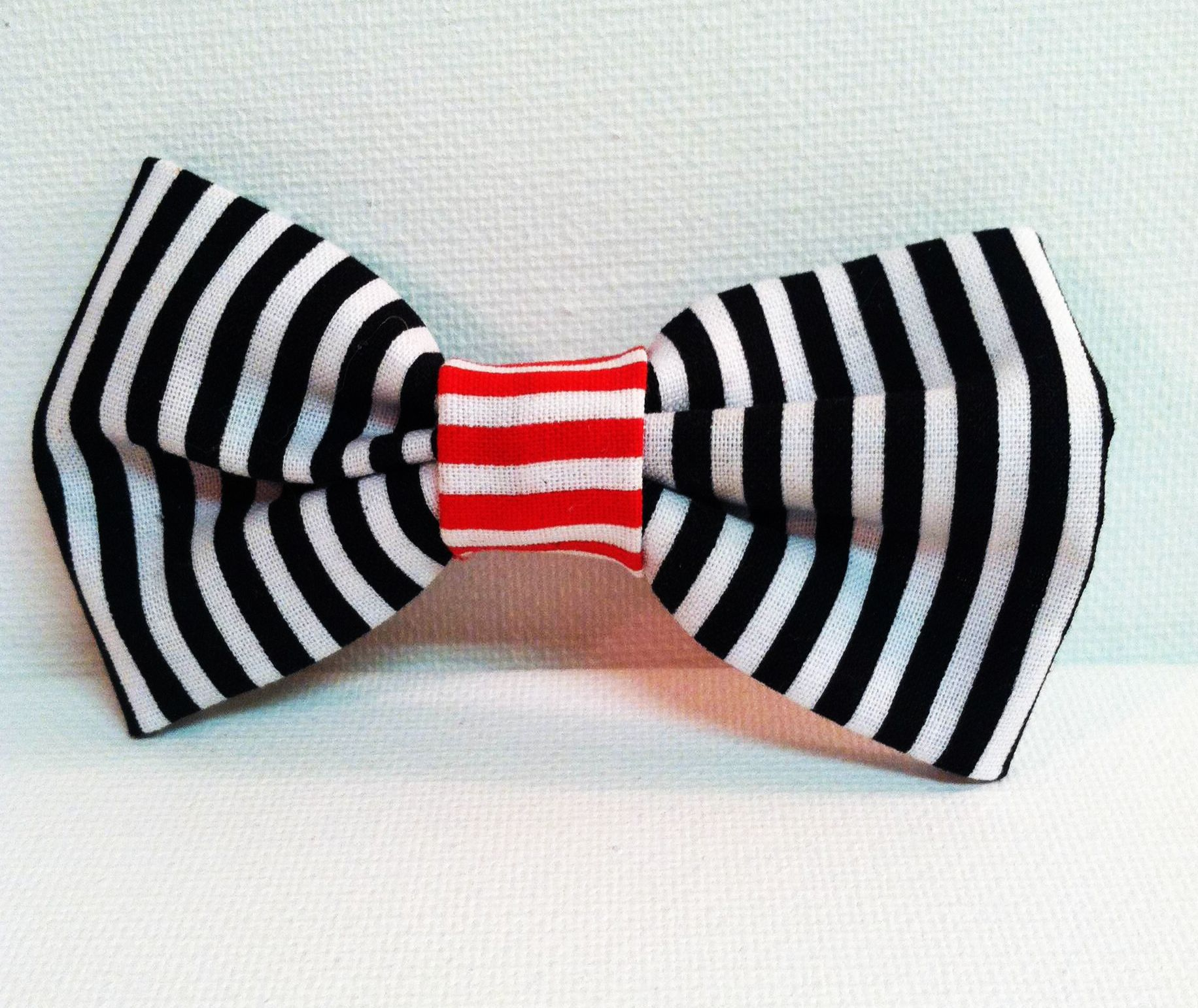 http://kuteasabuttonshop.storenvy.com/products/3783349-stripey-hair-bow