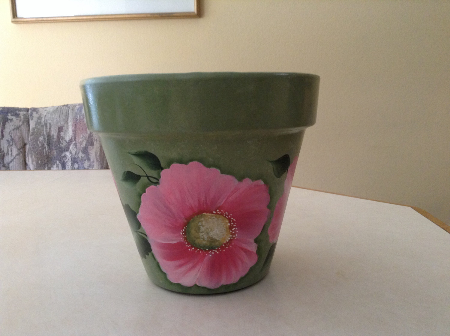 Storenvy & Handpainted flower pot soft green with pretty pink flowers and green leaves sold by Hand Painted by Tammy