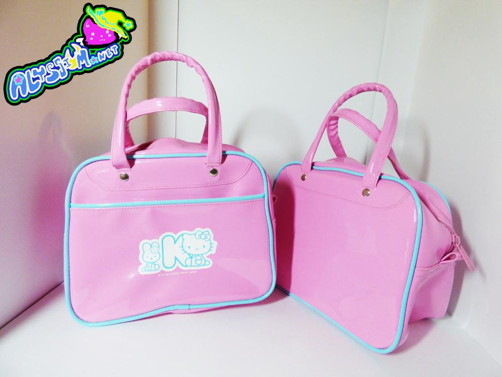 57d8a3d48a Hello Kitty Pink Vinyl Bowler Bag on Storenvy