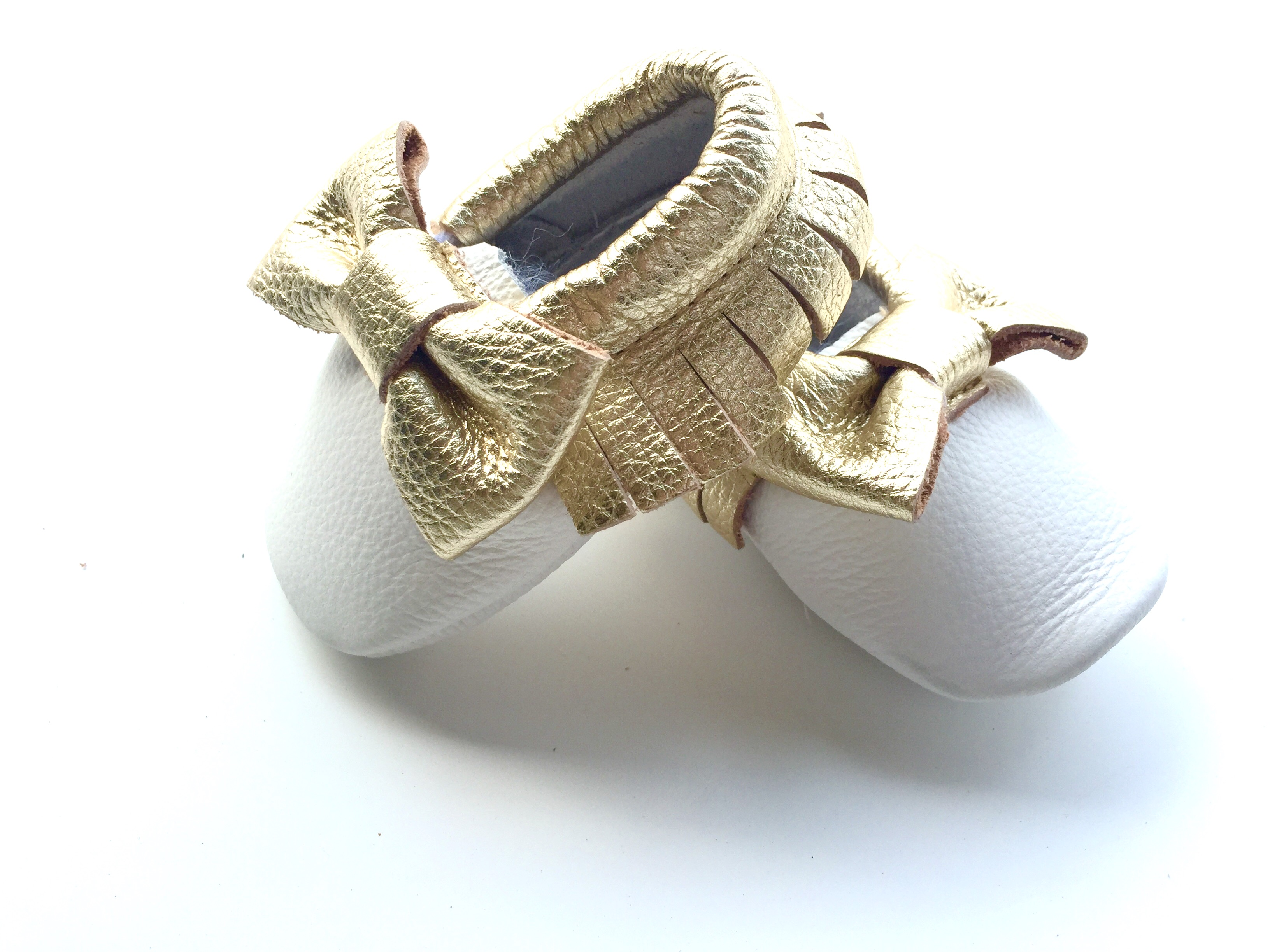 e085af306860d Baby Moccasins - White and Gold Leather with Bow from Blush + Willow