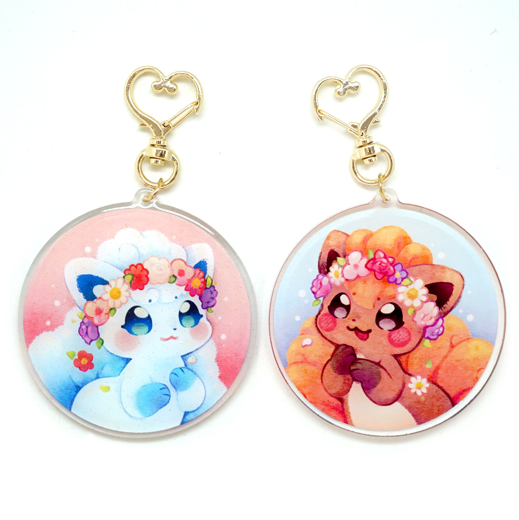 "CLEARANCE SALE: originally priced 10$, now 5.50$  ----  A BIG decorative and sparkly keychain of vulpix, with the alolan version on one side, and the kanto-ite version on the other side!  The 3"" (7,7cm) figure is printed on thick and sturdy clear acrylic board, and protected by a layer of ?glitter? Epoxy varnish. Both sides are printed. Side A is white vulpix, side B is regular vulpix.   They also come packaged in a clear cello bag!"