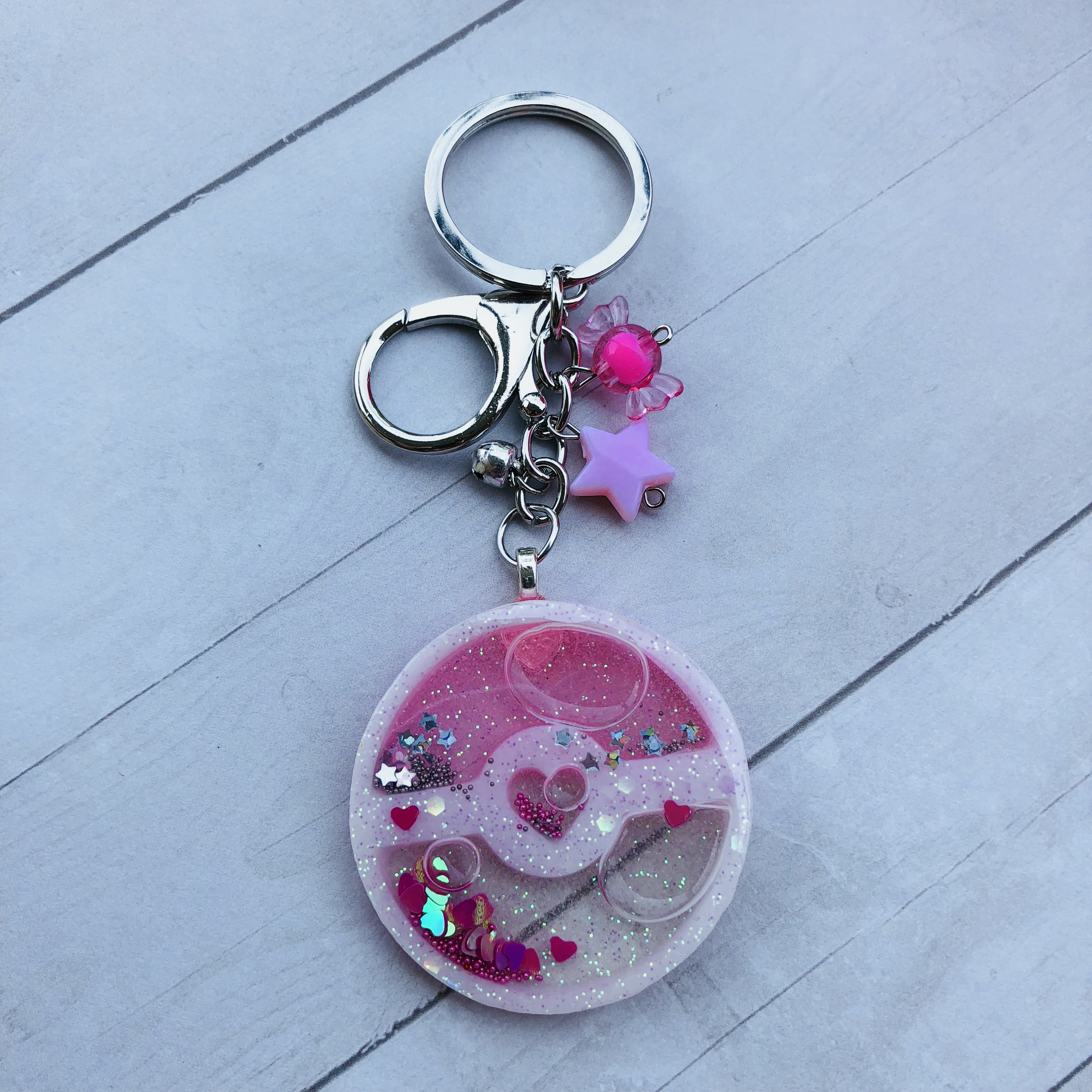 pink and blue resin keychain shakers